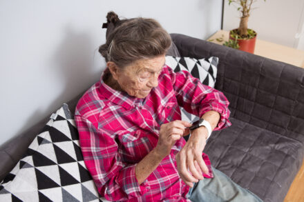 older woman looking at smartwatch