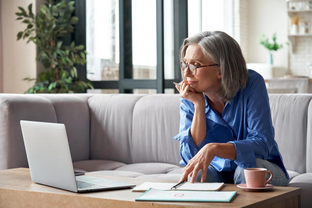 elder woman looking up information on masshealth
